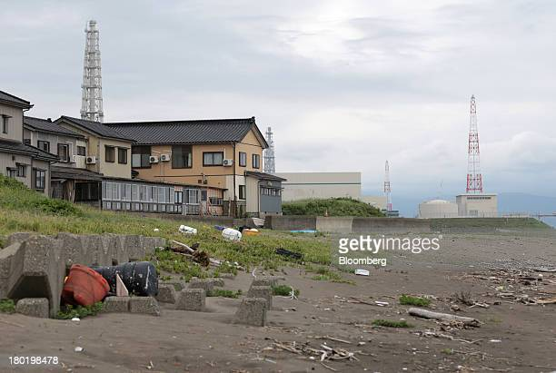 Residential houses stand near Tokyo Electric Power Co's Kashiwazaki Kariwa nuclear power station in Kashiwazaki City Niigata Prefecture Japan on...