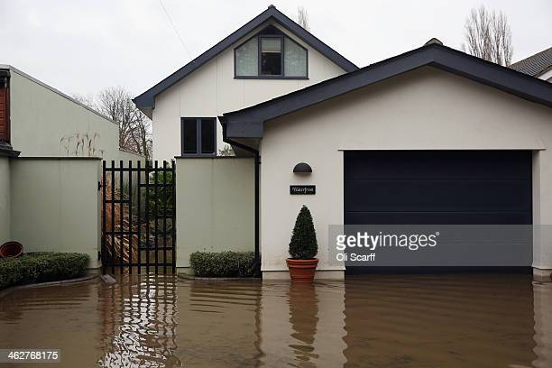 Residential properties are flooded by high water from the river Thames on January 15 2014 near Shepperton England The Environment Agency has recorded...