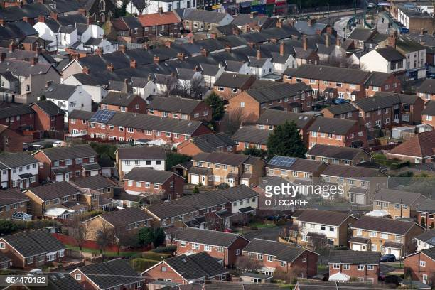 Residential properties are seen from the top of the outcrop Eston Nab overlooking Middlesbrough northern England on March 8 2017 / AFP PHOTO / OLI...