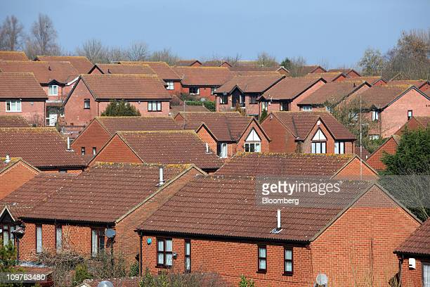 Residential properties are seen in Milton Keynes UK on Friday March 4 2011 UK house prices fell in February erasing a gain the previous month...