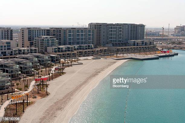 Residential properties operated by Aldar PJSC are seen beside a private beach at Al Zeina part of the Al Raha beach development in Abu Dhabi United...