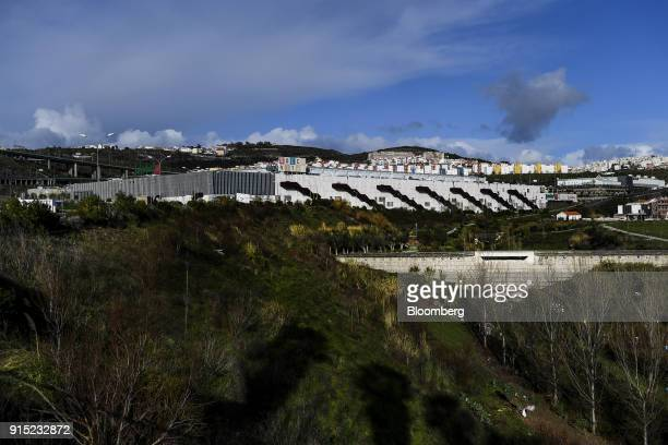 Residential properties sit on the skyline beyond the Dolce Vita Tejo shopping mall operated by AXA Real Estate Investment Managers SGR SpA in Lisbon...