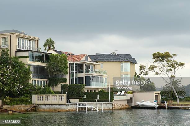 Residential properties stand by the waterfront in the suburb of Point Piper in Sydney Australia on Tuesday March 10 2015 Foreigners who illegally buy...