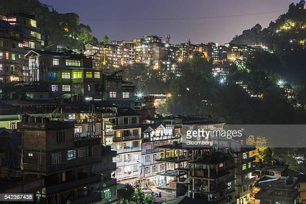 Residential properties stand illuminated at night on hillsides in Gangtok Sikkim India on Monday May 2 2016 For more than a decade in the Himalayan...