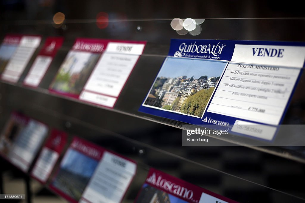 Residential property is displayed for sale in the window of an estate agent in Rome, Italy, on Friday, July 26, 2013. Italy's home prices are low enough to trigger an increase in purchases for the first time since 2006, though that won't lift values for at least two years, according to the Nomisma institute. Photographer: Alessia Pierdomenico/Bloomberg via Getty Images
