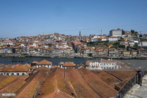 Residential property stand on the banks of the Douro River in Porto Portugal on Monday May 21 2018 Portugal's gross domestic product expanded less...