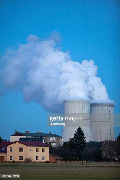 Residential property stands as vapor rises from the cooling towers of the Schwarze Pumpe lignite powered power plant operated by Vattenfall AB in...