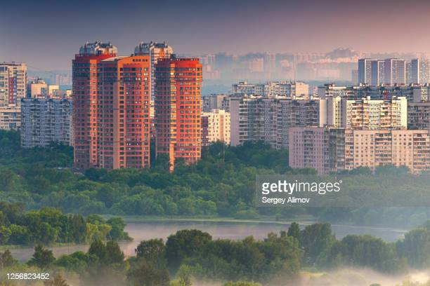 residential quarters strogino and foggy natural parkland in the morning - moscow russia stock pictures, royalty-free photos & images