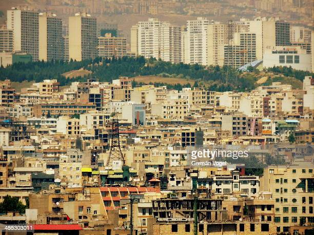 CONTENT] Residential skyline of central Tehran seen from the top of Azadi tower contrasting the lower architecture of older downtown buildings and...