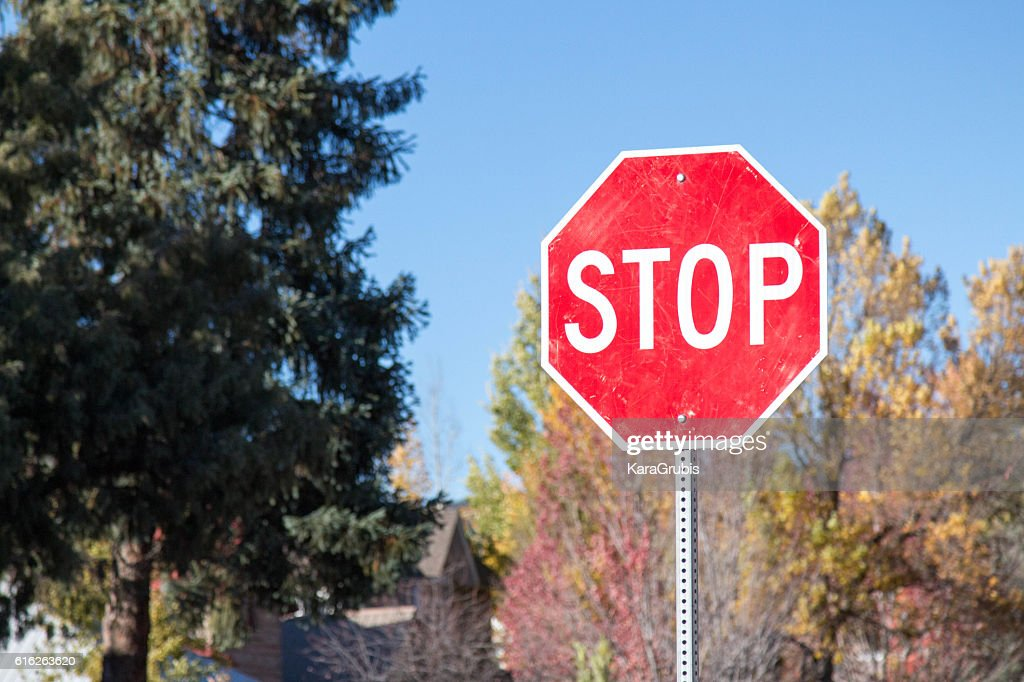 Residential stop sign in the autumn : Stock Photo