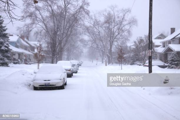 Residential street covered in snow after a blizard