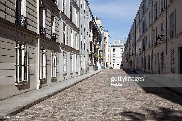 a residential street, paris, france - cobblestone stock pictures, royalty-free photos & images