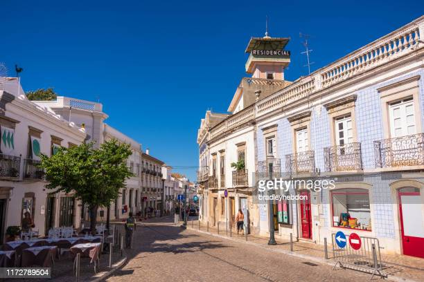 residential tower above rua da liberdade in tavira, portugal - rua stock pictures, royalty-free photos & images