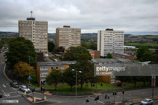 Residential tower blocks and lowrise housing are pictured adjacent to the ring road in the city centre of StokeonTrent northern England on October 1...