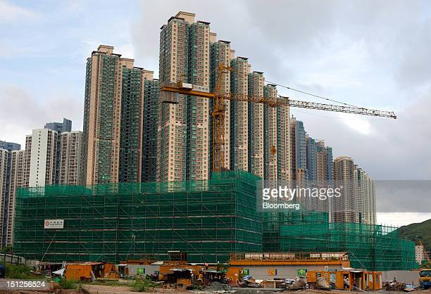 Residential tower blocks stand behind a construction site in the Tseung Kwan O area of the New Territories in Hong Kong China on Tuesday Sept 4 2012...