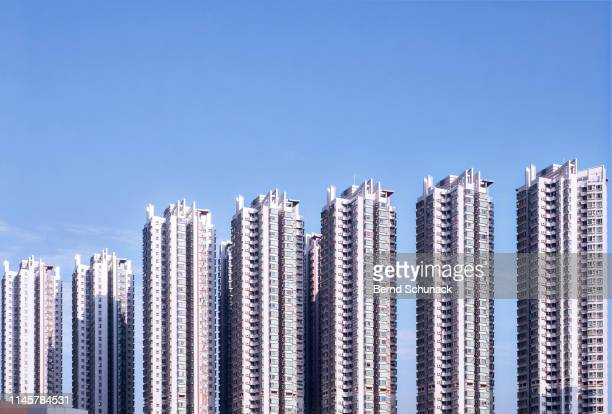 residential towers in hong kong - bernd schunack stock photos and pictures