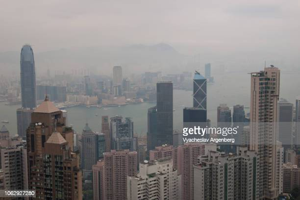 residential towers of hong kong, rainy weather - argenberg stock-fotos und bilder