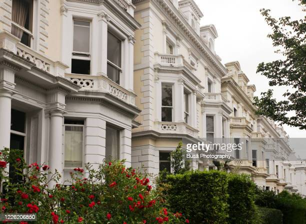 residential townhouses in london's notting hill district, one of the uk's most expensive residential areas. london, england - real estate stock pictures, royalty-free photos & images