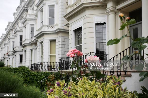 residential townhouses in london's notting hill district, one of the uk's most expensive residential areas. london, england - residential district stock pictures, royalty-free photos & images