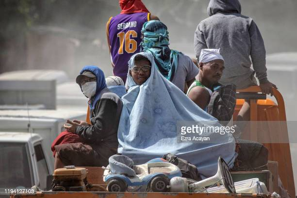 Residents aboard a truck pass a checkpoint after they were briefly allowed to return to their homes to recover their belongings at the permanent...