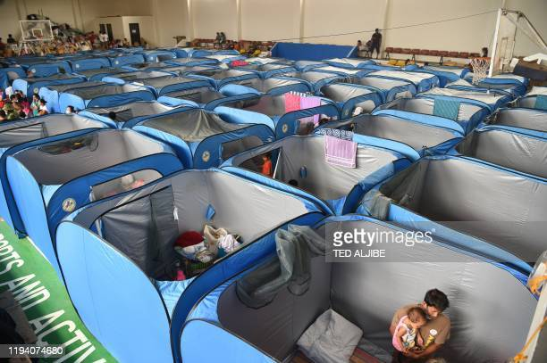 TOPSHOT Residents affected by the eruption of Taal volcano gather at an evacuation centre in Tagaytay City Philippines' Cavite province on January 17...