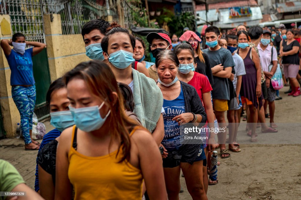 Residents Crowd An Evacuation Centre In The Aftermath Of Typhoon Vamco : News Photo