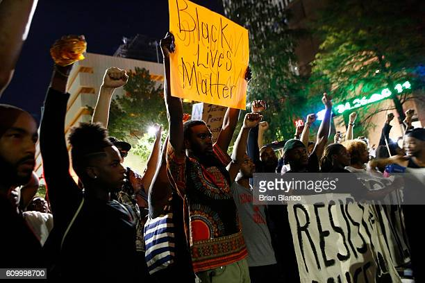 Residents and activists march in the streets amid heavy police and North Carolina National Guard presence as they protest the death of Keith Lamont...