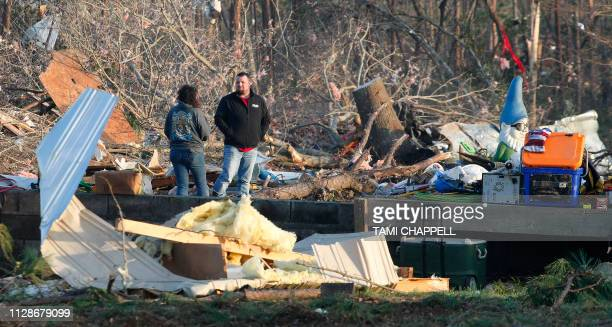 Residents and friends help clean up after a tornado struck in Beauregard Alabama on March 4 2019 Rescuers in Alabama resumed search operations Monday...