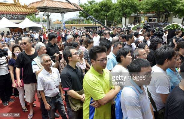 Residents and mourners gather to pay their last respects to late Taiwanese celebrity Chu Keliang at the hall of a local funeral parlor in New Taipei...