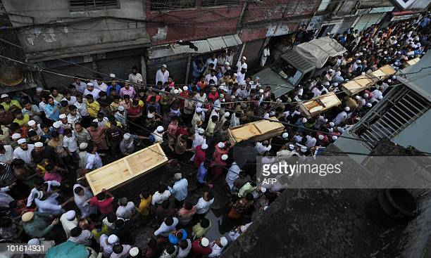 Residents and relatives carry the coffins of victims of the previous day's fire in Old Dhaka on June 4 2010 Bangladeshi firefighters said Friday an...
