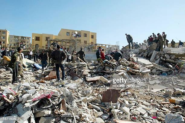 Residents and rescuers search the debris near Boumerdes 22 May 2003 after a powerful earthquake hit the Algiers region late 21 May At least 538...