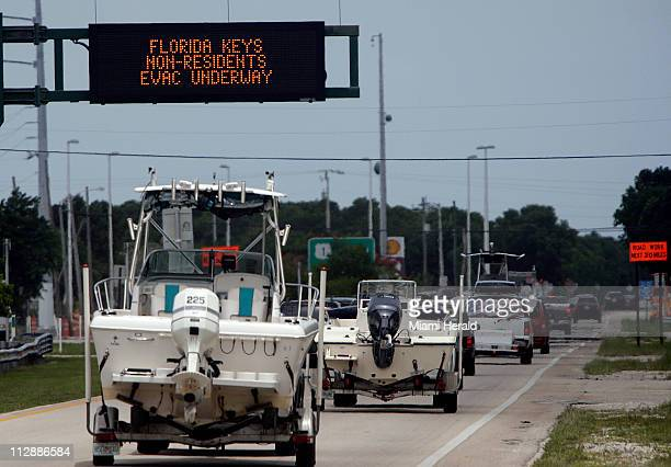 Residents and tourists evacuate the Florida Keys through Key Largo Florida after a hurricane watch was posted in anticipation of Tropical Storm Fay...