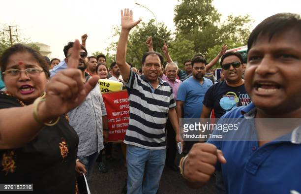 Residents and villagers during a protest march against dumping ground at sector 123 on June 16 2018 in Noida India The National Green Tribunal issued...