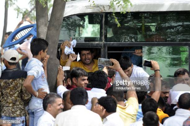 Residents and villagers during a protest march against dumping ground at Sector 123 on June 17 2018 in Noida India The National Green Tribunal issued...