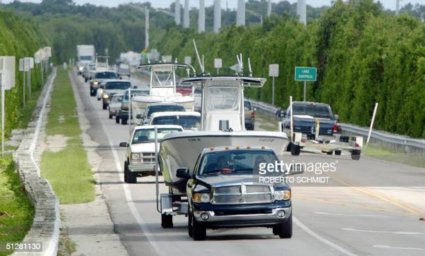 Residents and visitors of the Florida Keys drive north on highway US 1 09 September 2004 hours after local authorities ordered a mandatory evacuation...