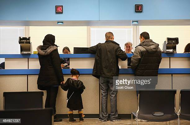 Residents apply for or renew their driver's license at a driver services facility on December 10 2013 in Chicago Illinois Illinois recently began a...