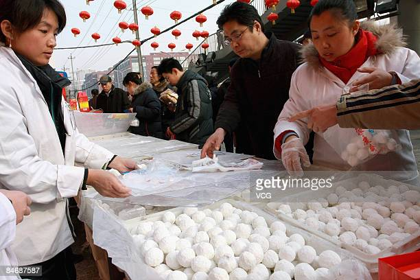 Residents are buying Tangyuan or Yuanxian in Beijing China on February 8 2009 Tangyuan the small dumpling balls are usually made of sticky rice flour...