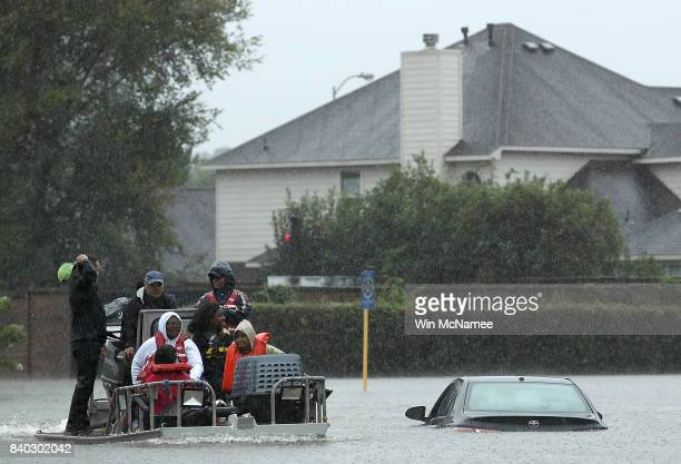 Residents are evacuated from their homes after severe flooding following Hurricane Harvey in the Cypresswood Creek subdivision in north Houston...