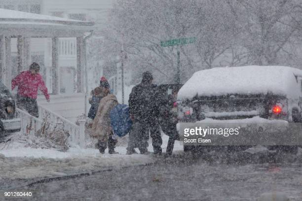 Residents are evacuated via a humvee as flood waters rises as a massive winter storm bears down on the region on January 4 2018 in Scituate...