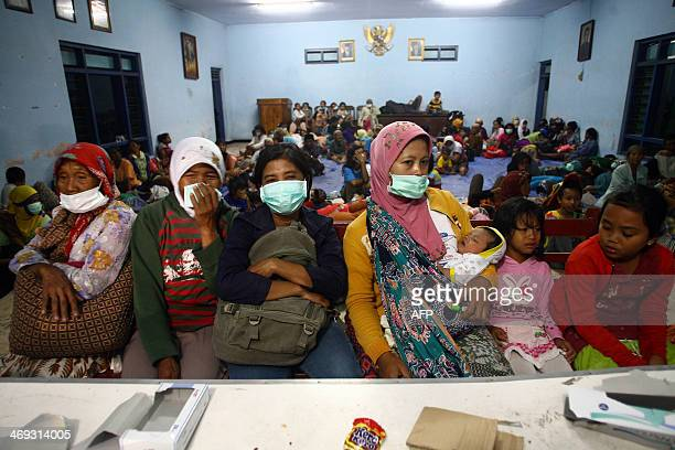 Residents are housed in a community hall during a mass evacuation of Kediri in East Java province following the eruption of Mount Kelud volcano on...