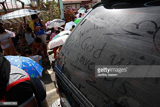 Residents are seen as they charge their mobile phones along the road in Tacloban on November 15 2013 in Tacloban Philippines Typhoon Haiyan which...