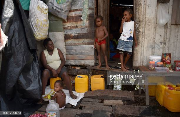 Residents are seen in the village of Hanuabada one of only two remaining stilt villages in Port Moresby on November 15 2018 ahead of the AsiaPacific...