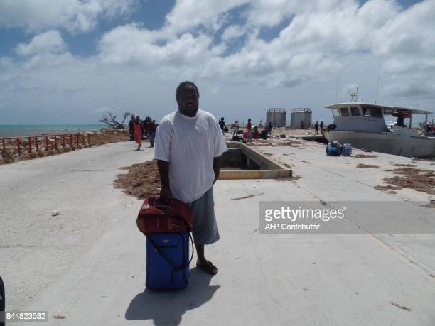 Residents are seen on September 8 2017 in Codrington Antigua and Barbuda devastated by Hurricane Irma Hurricane Irma on Thursday slashed its way...