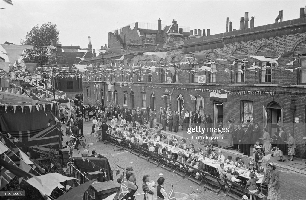 Residents at a street party to celebrate the coronation of Queen Elizabeth II, held in Morpeth Street in London's East End, 2nd June 1953. Original publication: Picture Post - 6542 - Cockneys' Own Party - pub. 13th June 1953