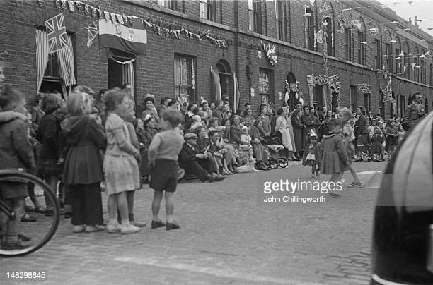 Residents at a street party to celebrate the coronation of Queen Elizabeth II held in Morpeth Street in London's East End 2nd June 1953 Original...