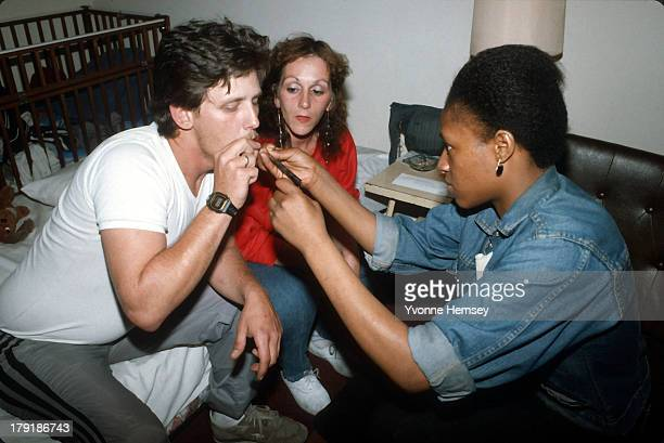 Residents at a welfare hotel are photographed smoking crack May 20 1986 New York City