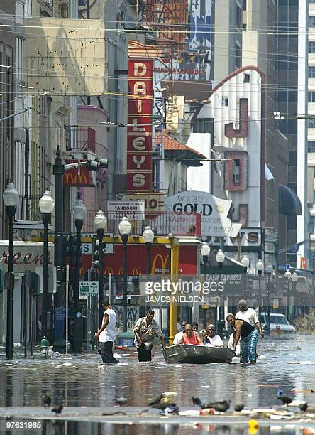 Residents attempt to escape flood waters 31 August 2005 in New Orleans Louisiana in aftermath of Hurricane Katrina With most of New Orleans submerged...