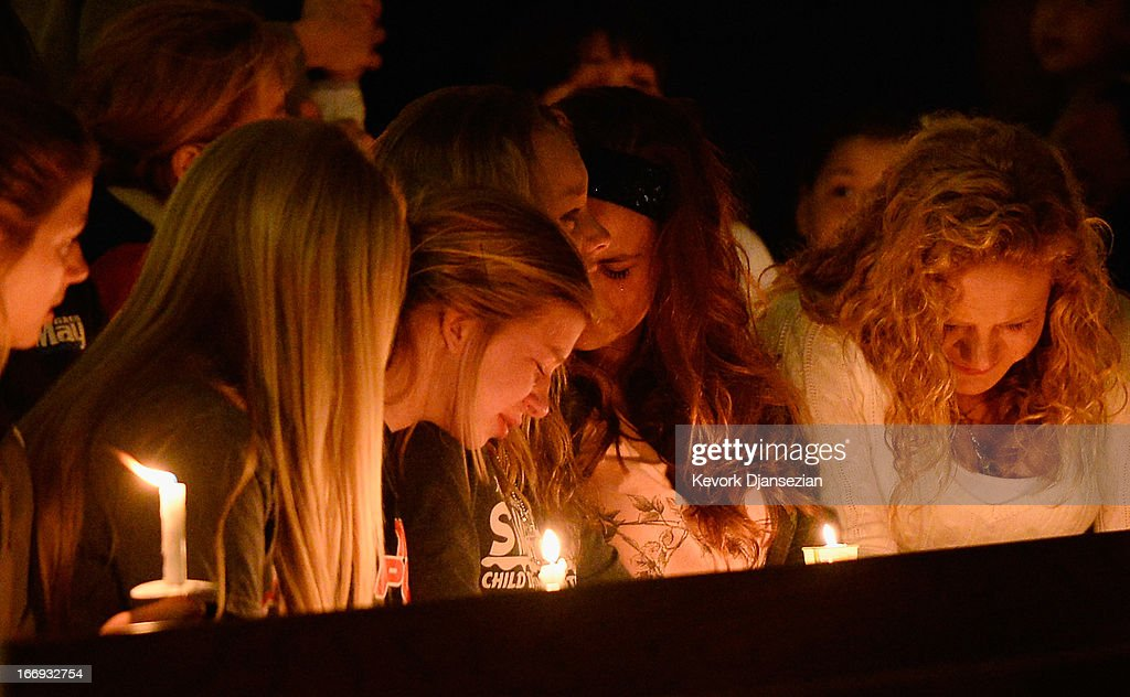 Residents attend a candelight vigil and prayer honoring the victims of West Fertilizer Company explosion at St. Mary's Assumption Catholic Church April 18, 2013 in West, Texas. A fiery explosion that damaged or destroyed buildings within a half-mile radius ripped through the facility last night, injuring more than 160 people and killing an unknown number of others.