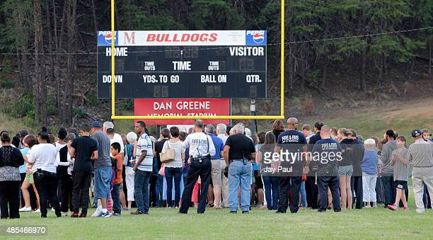 Residents attend a candlelight vigil for Alison Parker on Martinsville High School's football field on August 27 2015 in Martinsville Virginia Two...