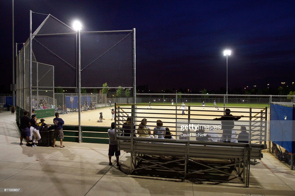 Residents attend a peewee baseball game south of the San Andreas Rift Zone, the system of depressions in the ground between the parallel faults of the San Andreas earthquake fault, which runs along the northern edge of the city, May 14, 2008 in San Bernardino, California. New calculations reveal a 99.7 percent chance that a magnitude 6.7 quake or larger will strike by 2037, according to the first-ever statewide temblor forecast released by the scientists of the United States Geological (USGS), Southern California Earthquake Center and California Geological Survey last month. Scientists have particular concern for the people living along the southern portion of the 800-mile-long San Andreas Fault east of Los Angeles. This section of the fault has had very little slippage for more than 300 years and has built up immense pressure that could release an earthquake of historic proportions at any time. Such a quake could produce a sudden lateral movement of 23 to 32 feet and be would be among the largest ever recorded. Experts have predicted that a quake of magnitude-7.6 or greater on the southern San Andreas would kill thousands of people and cause many billions of dollars in damages, dwarfing the 1994 Northridge disaster near Los Angeles that killed 72 people, injured more than 9,000 and caused $25 billion in damage.